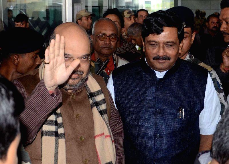 BJP chief Amit Shah arrives at Netaji Subhas Chandra Bose Airport in Kolkata, on Jan 20, 2015. Also seen West Bengal BJP chief Rahul Sinha. - Rahul Sinha