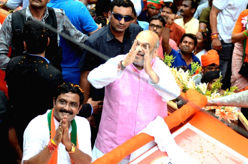 Kolkata: BJP chief Amit Shah during a road show in Kolkata on May 14, 2019. (Photo: IANS)