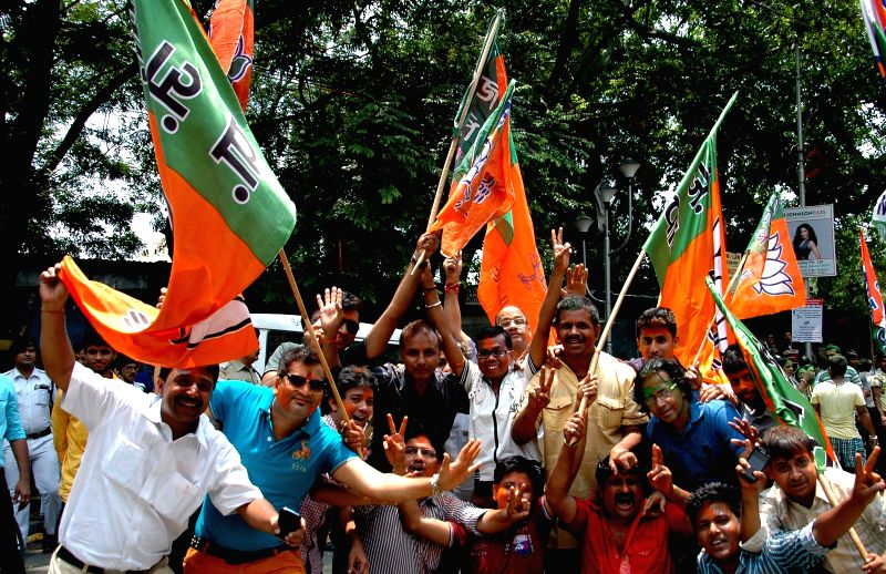 BJP workers celebrate party`s performance in the recently concluded West Bengal civic polls, in Kolkata, on April 28, 2015.