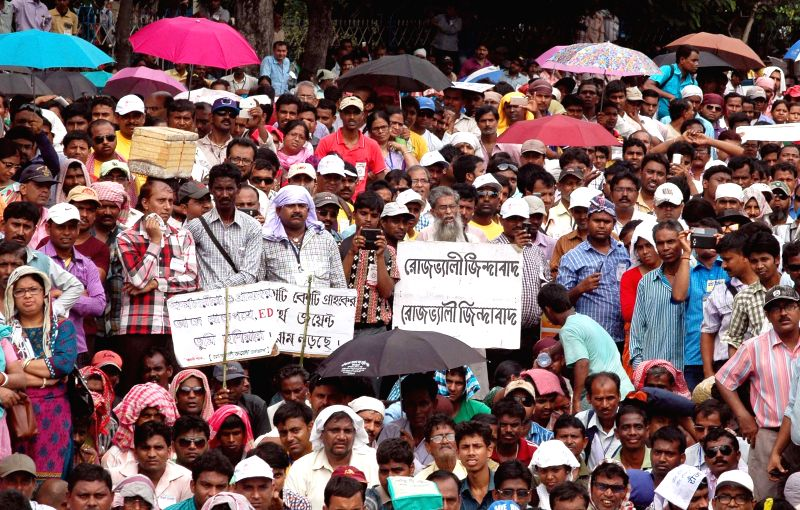 BJP workers participate in a party rally in Kolkata on April 12, 2015.