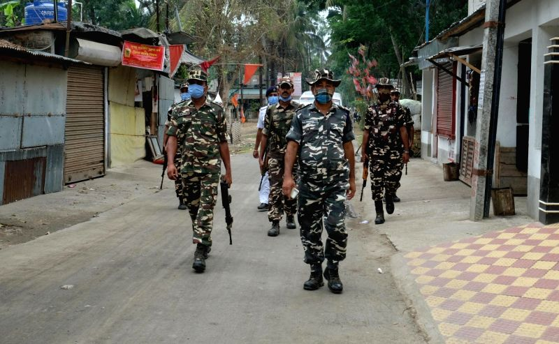 Kolkata  :  Bongaon 6th Phase Election 3 : Bongaon, 22nd April 2021 : Central Force jawans patrolling  outside a polling booth of Bongaon during the 6th phase of West Bengal Assembly Election on Thursday 22nd April 2021.(Photo: Subhendu Ghosh/IANS)