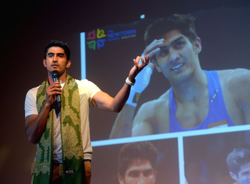 Kolkata: Boxer Vijender Singh addresses students during a motivational session at a school, in Kolkata on July 17, 2018.  , in Kolkata on July 17, 2018.