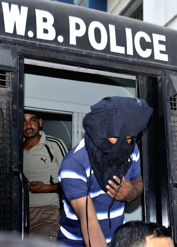 Burdwan blast accused Abdul Wahab Momin being produced at a city court by NIA official in Kolkata on March 22, 2015.