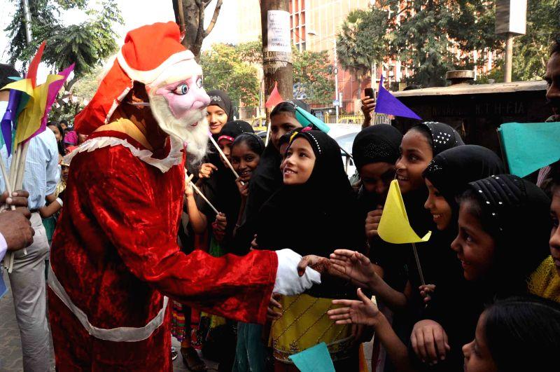 Children celebrate Christmas near the Mother House in Kolkata on Dec 22, 2014.