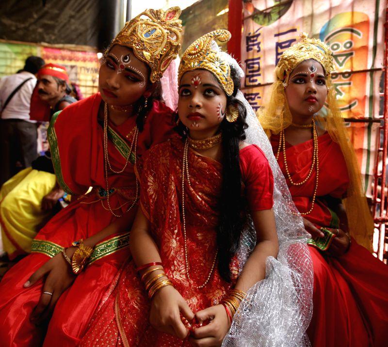 Kolkata Children disguise as Parvati during Shiva Gajan Festival in Kolkata, on April 13, 2015.