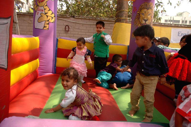Children during a test-tube baby show organised in Behala, Kolkata on Feb 8, 2015.