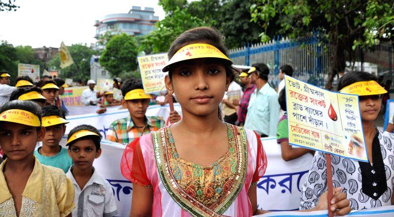 Children participate in a blood donation campaign in Kolkata, on April 12, 2015.