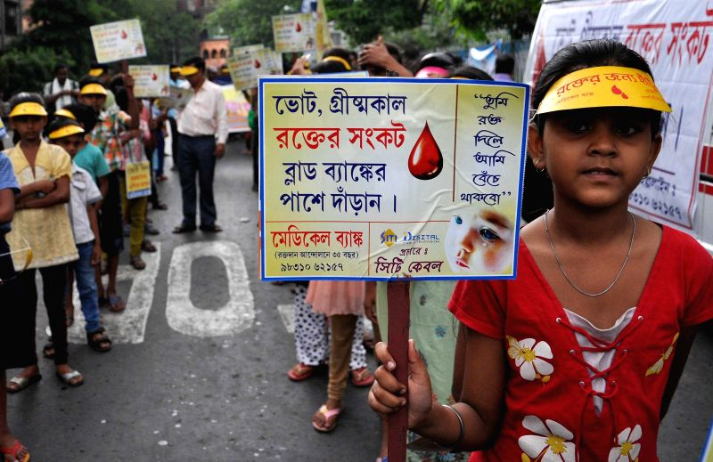 Children participate in a blood donation campaign in Kolkata, on April 12, 2015.