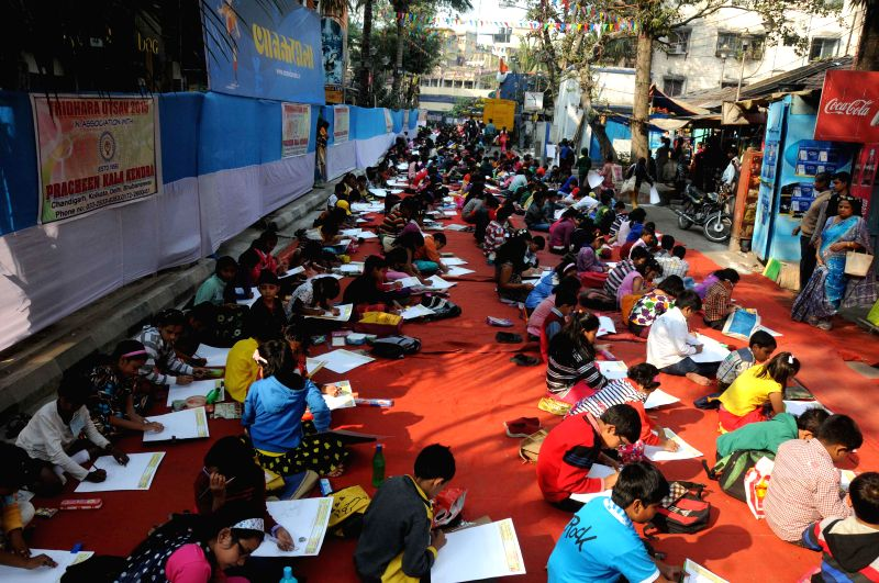 Children participate in a sit and draw competition organised on Netaji Subhas Chandra Bose's birth anniversary in Kolkata, on Jan 23, 2015.