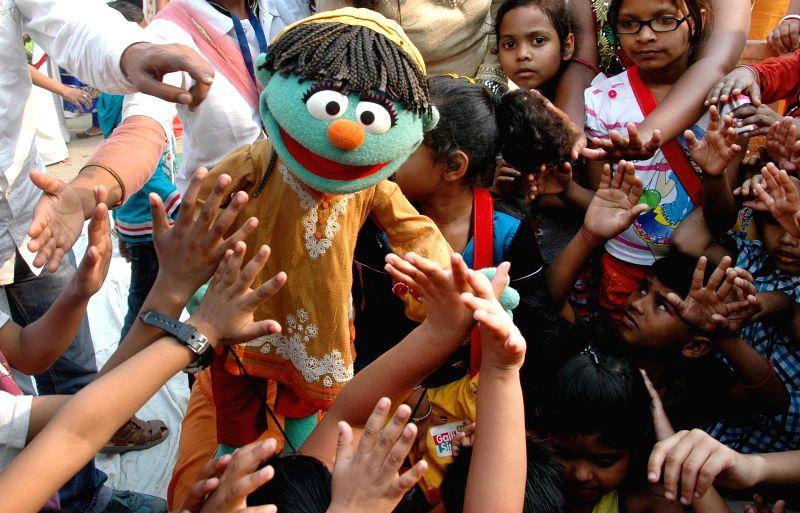 Children participate in `Galli Galli Sim Sim` - an education programme in Kolkata, on Feb 12, 2015.