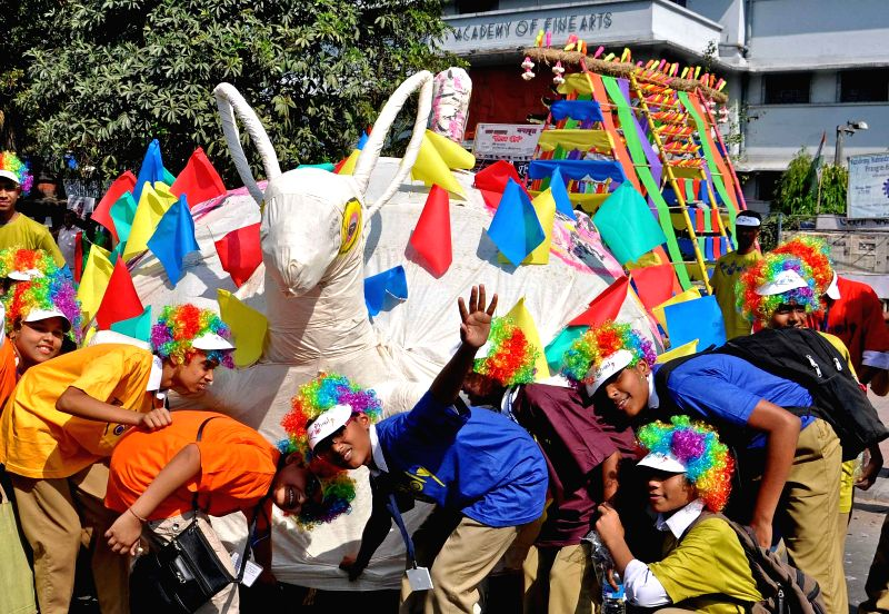 Children participate in `Rongholi` - a campaign against `Excessive pressure on children` in Kolkata on March 13, 2015.