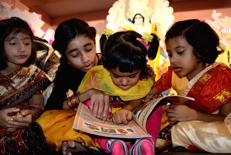 Children participate in Saraswati puja at their school premises in Kolkata on Jan 24, 2015.