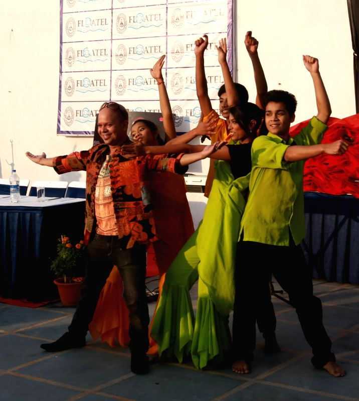 Children perform at the launch of singer Neepabithi Ghosh's new album `Iconic` on Boxing Day in Kolkata, on Dec 26, 2014.