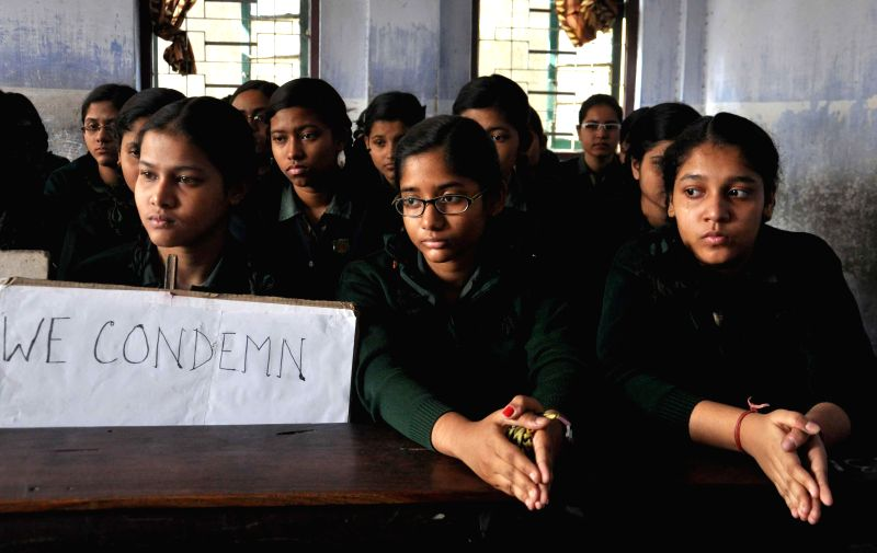 Children protest against Tuesday's attack on the Army Public School in Peshawar, Pakistan, that claimed 104 lives mostly those of children, in Kolkata, on Dec 17, 2014.