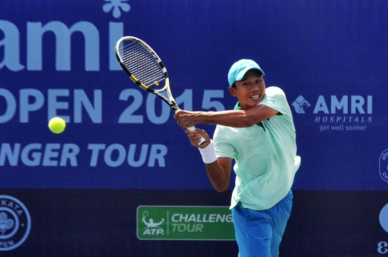 Chinese Taipei tennis player Chen Ti in action against Indian tennis player Ramkumar Ramanathan during an Emami Kolkata Open 2015- ATP Challenger match in Kolkata on Feb 26, 2015.