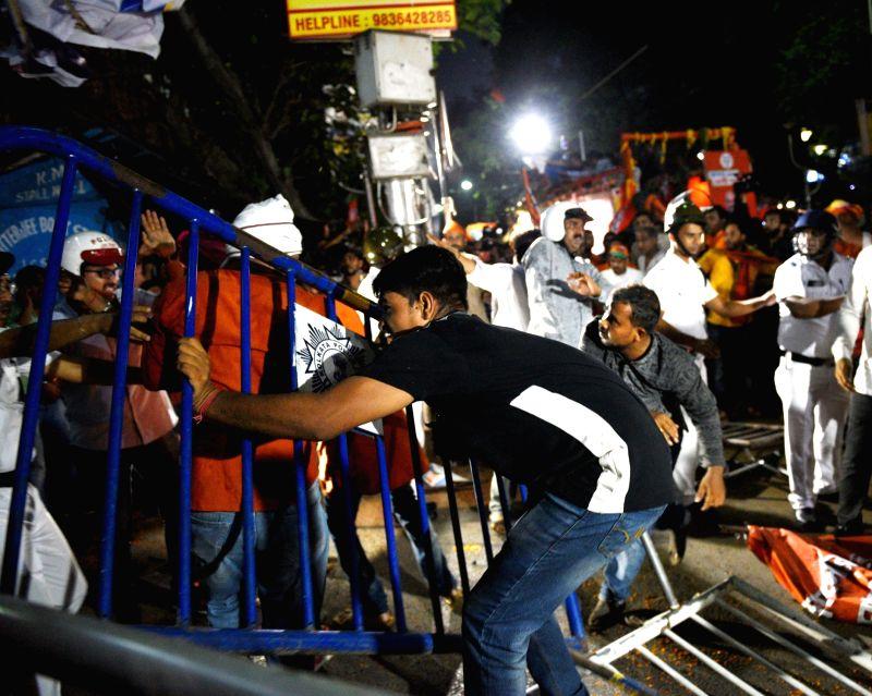 Kolkata: Clashes broke out during BJP President Amit Shah's roadshow, in Kolkata, on May 14, 2019.