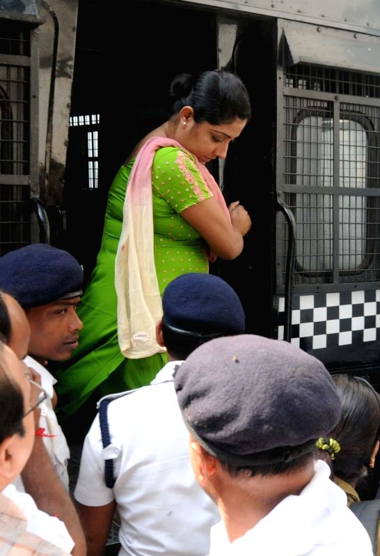 Close aide of Saradha scam kingpin Sudipta Sen, Debjani Mukherjee being taken to be produced at a Kolkata court in connection with multi-crore-rupee Sardha chit fund scam on Nov 27, 2014.