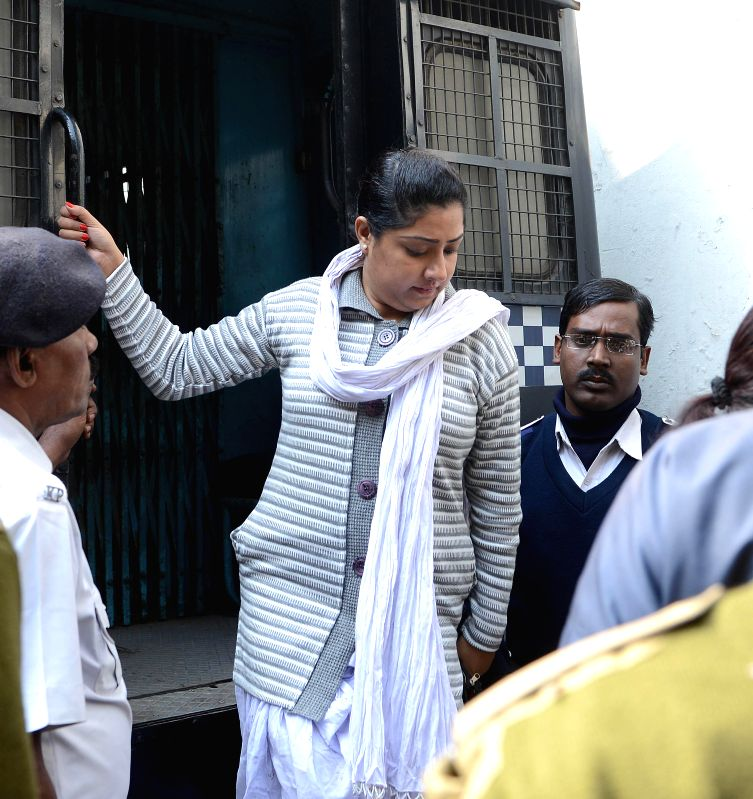 Close aide of Saradha scam kingpin Sudipta Sen, Debjani Mukherjee being taken to be produced at a Kolkata court in connection with multi-crore-rupee Sardha chit fund scam on Dec 22, 2014.