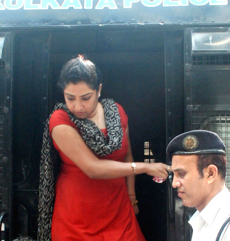 Close aide of Saradha scam kingpin Sudipta Sen, Debjani Mukherjee being taken to be produced at a Kolkata court in connection with multi-crore-rupee Sardha chit fund scam on March 13, 2015.