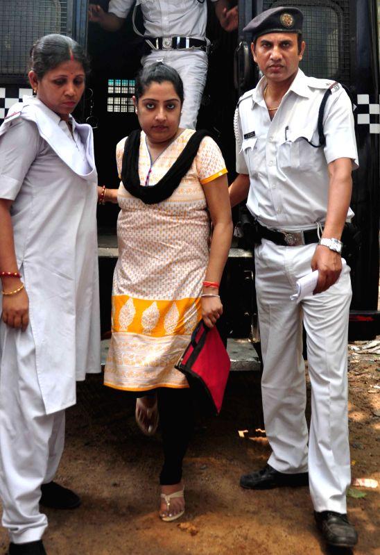 Close aide of Saradha scam kingpin Sudipta Sen, Debjani Mukherjee being taken to be produced at a Kolkata court in connection with multi-crore-rupee Sardha chit fund scam  on April 6, 2015.