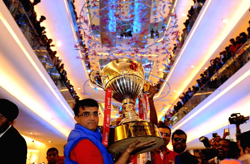 Co-owner of the Atletico de Kolkata Sourav Ganguly lifts the ISL Trophy during a programme organised to celebrate teams victory in ISL finals  in Kolkata, on Dec 21, 2014. - Sourav Ganguly