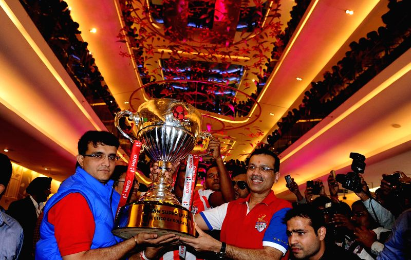 Co-owners of the Atletico de Kolkata,  Sanjiv Goenka and Sourav Ganguly lift the ISL Trophy during a programme organised to celebrate teams victory in ISL finals  in Kolkata, on Dec 21, ... - Sourav Ganguly and Sanjiv Goenka