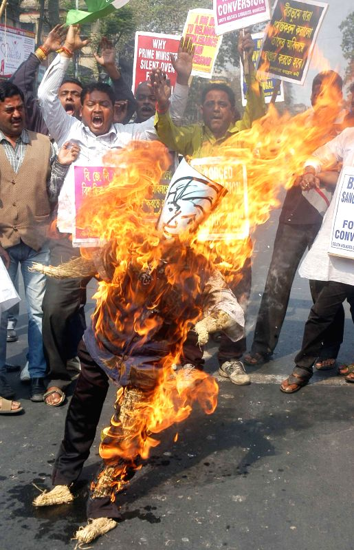 Congress workers burn effigy of VHP leader Praveen Togadia during a demonstration in Kolkata, on Feb 8, 2015.
