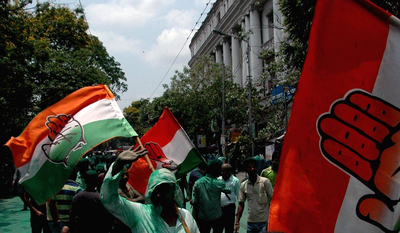 Congress workers' celebrate party's performance in the recently concluded West Bengal civic polls, in Kolkata, on April 28, 2015.