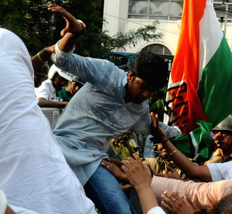 Congress workers participate in `Lalbazar Abhiyan` to protest against violence during KMC polls in Kolkata on April 21, 2015.