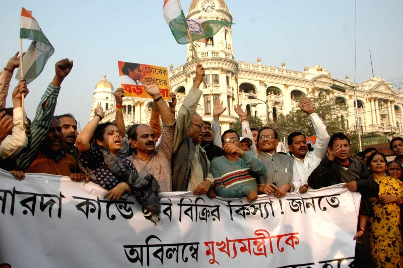 Congress workers stage a demonstration against Mamata Banerjee led West Bengal Government in Kolkata, on Dec 15, 2014. - Mamata Banerjee