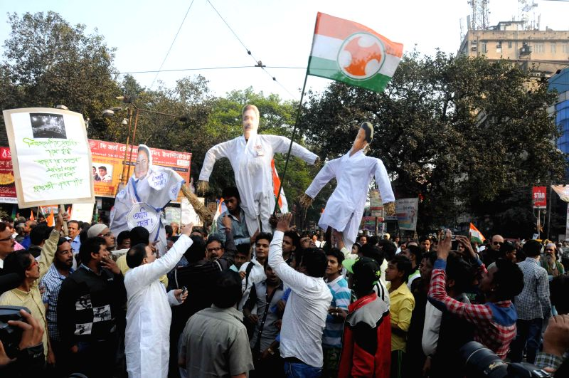Congress workers stage a demonstration against West Bengal Chief Minister Mamata Banerjee, West Bengal Transport Minister Madan Mitra and Trinamool Congress leader Mukul Roy in Kolkata, on ..