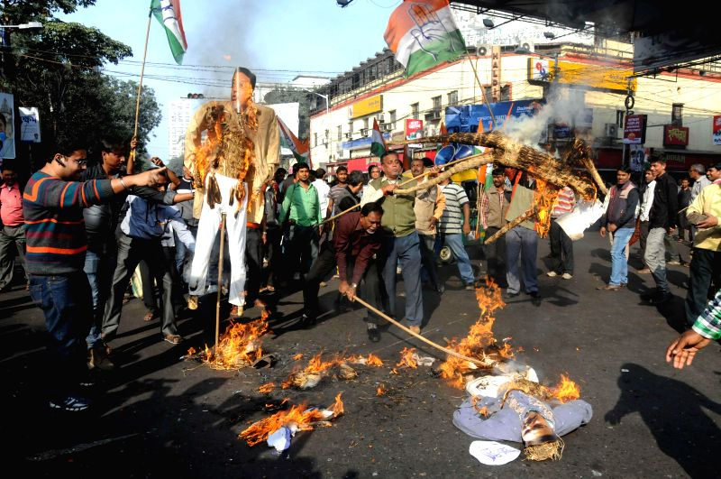 Congress workers stage a demonstration to demand proper investigations in Saradha Chit fund scam in Kolkata, on Jan 15, 2015.