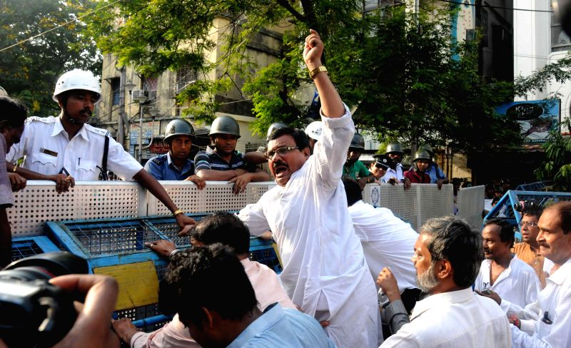 Congress workers try to break the police barricades during `Lalbazar Abhiyan` to protest against violence during KMC polls in Kolkata on April 21, 2015.