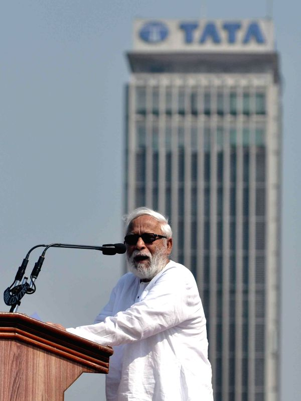 CPI (M) leader Buddhadeb Bhattacharya addresses during the 24th West Bengal State Conference of the party being held at the Brigade Parade Ground in Kolkata, on March 8, 2015.