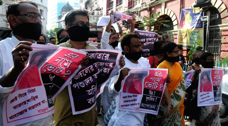 CPI-M leader Rupa Bagchi and other leaders stage a protest against West Bengal Government in Kolkata on April 20, 2015.
