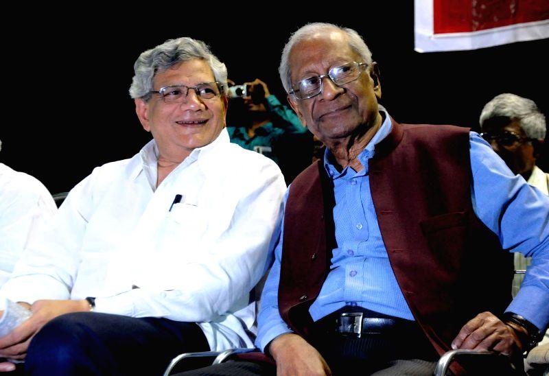 CPI (M) leader Sitaram Yechury and CPI leader Ardhendu Bhushan Bardhan during a programme in Kolkata, on Nov 18, 2014. - Sitaram Yechury