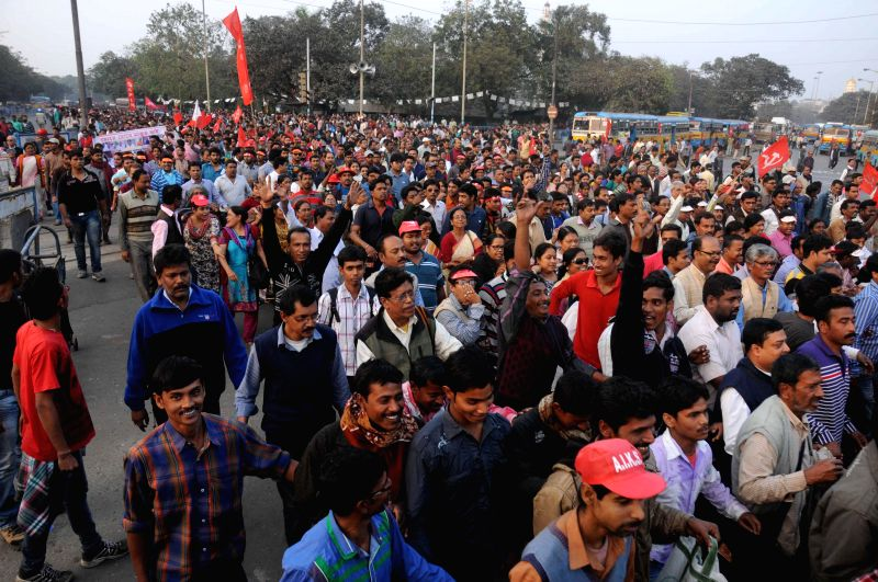 CPI (M) workers march towards Nabanno - the West Bengal secretariat as they demonstrate against West Bengal government in Kolkata on Dec 16, 2014.