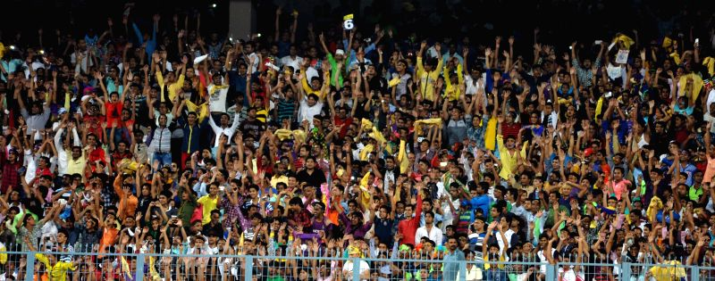 Cricket fans during an IPL-2015 match between Kolkata Knight Riders and Mumbai Indians in Kolkata, on April 8, 2015.