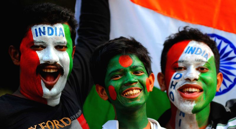 Cricket fans get their faces painted in the colours of India and Bangladesh ahead of the ICC World Cup-2015 quarter final match between the two nations in Kolkata on March 18.