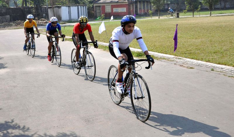 Cyclists participate in 35th State Cycling Championship in Kolkata on Feb 1, 2015.