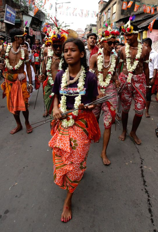 Kolkata : Devotees celebrate Shiva Gajan Festival in Kolkata, on April 13, 2015.