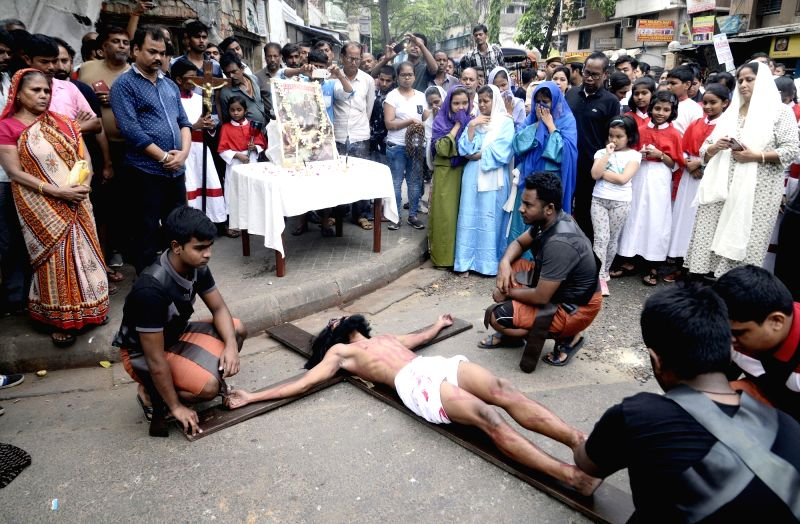 Kolkata: Devotees participate in a re-enactment of the crucifixion of Jesus Christ on the occasion of Good Friday in Kolkata, on April 19, 2019. (Photo: Kuntal Chakrabarty/IANS)