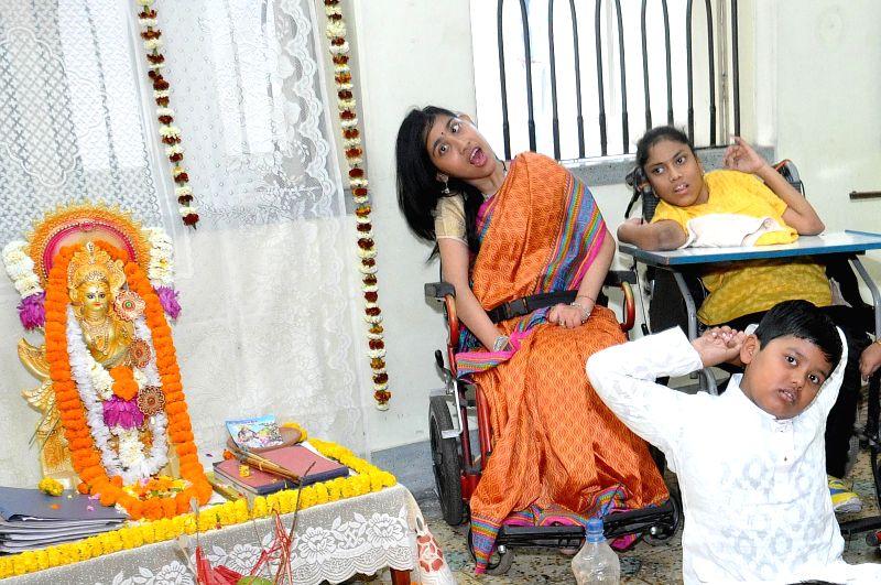 Differently-abled children celebrate Saraswati Puja at their school in Kolkata, on Jan 25, 2015.