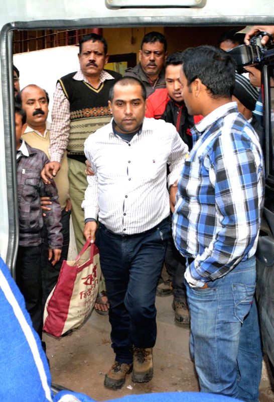 Director of Kolkata-based firm Saradha Realty Shib Narayan Das being taken to be produced before a court in connection with multi-crore-rupee Saradha chit fund scam in Kolkata, on Jan 18, ...