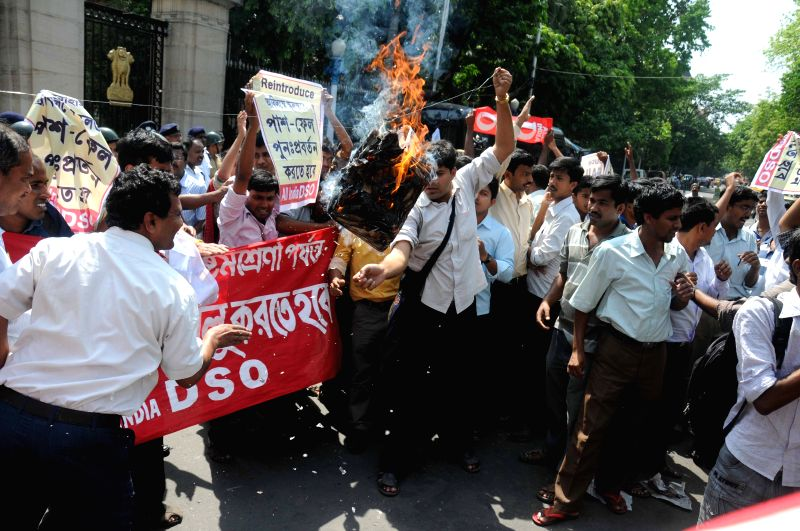 DSO activists stage a demonstration outside Raj Bhawan to press for re-introduction of pass-fail system in schools in Kolkata on April 9, 2015.