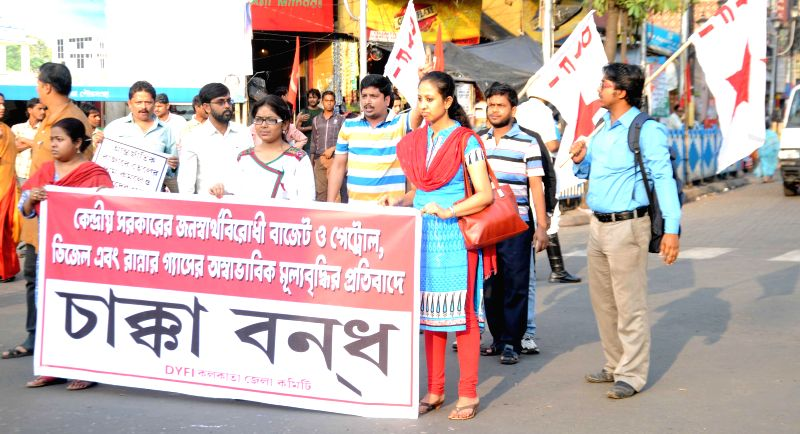 DYFI workers stage a demonstration to protest against the national budget 2015-16 in Kolkata, on March 4, 2015.