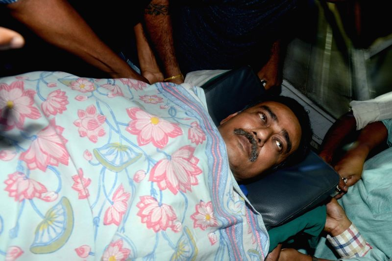 East Bengal Club official Debabrata Sarkar being taken away from a state run hospital after he was granted conditional bail in Saradha Chit Fund scam in Kolkata on March 25, 2015.