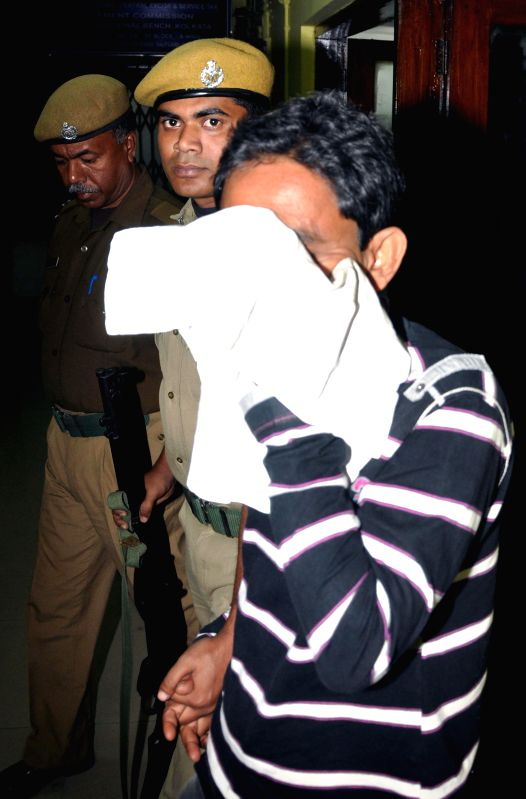 ED (Enforcement Directorate) officials take away Saradha agent Prasanta Naskar after arresting him in connection with the multi-crore-rupee Saradha chit fund scam  on Feb 13, 2015.