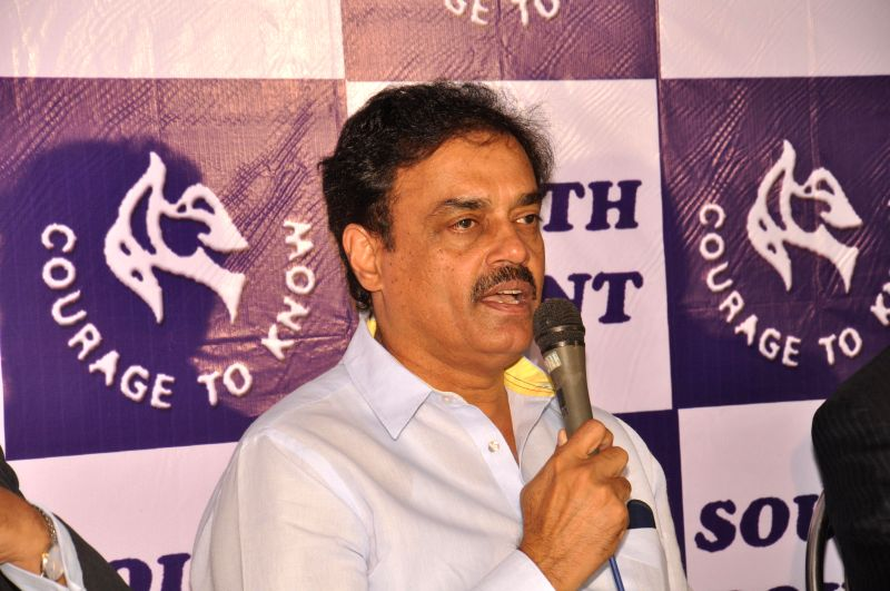 Eminent cricketer and cricket administrator Dilip Vengsarkar hands over the prizes during the Annual Sports day of South Point High School at Gitanjali Stadium in Kolkata on Dec 21, 2014.