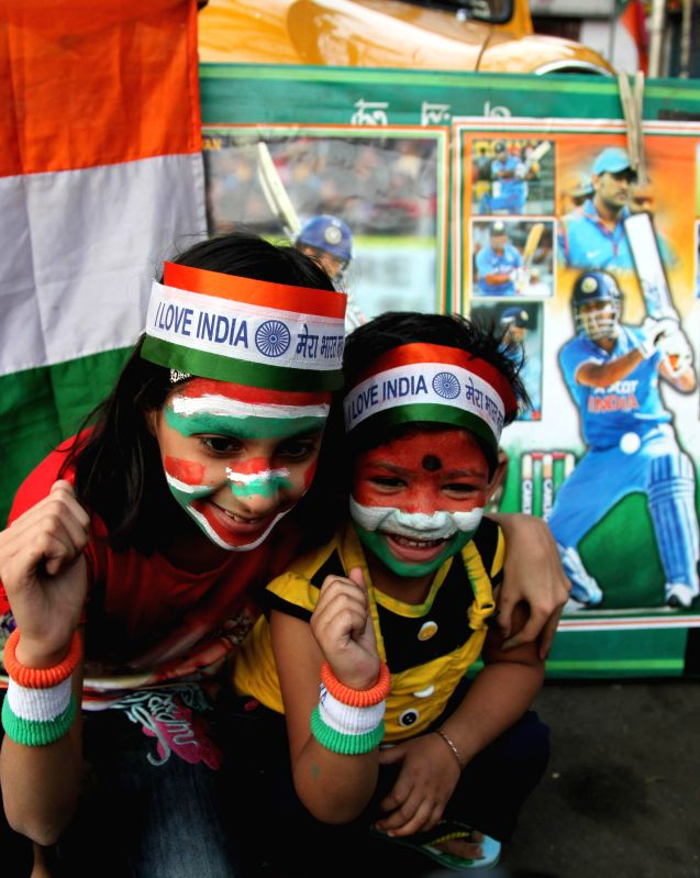 Fans celebrate after India defeated South Africa in an ICC World Cup 2015 match played at Melbourne Cricket Ground; in Kolkata on Feb 22, 2015.